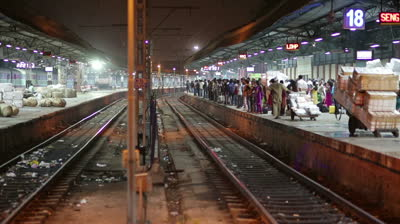 stock-footage-mumbai-india-march-group-of-people-waiting-on-railway-station-platform-at-night-litter